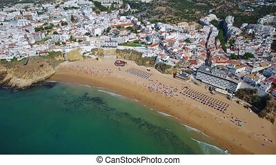 The magnificent beach of fishermen, in the city of Albufeira, view from the sky.