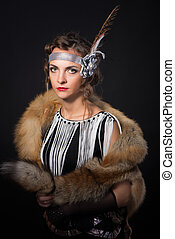 The magnificent girl with a skin of fox and feather in...