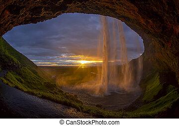 the majestic Seljalandsfoss Falls against the sunset. Iceland