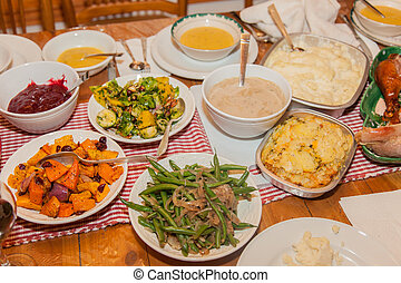 The majority of the dishes in the traditional American version of Thanksgiving dinner are made from foods native to the New World, as according to tradition the Pilgrims received these foods from the Native Americans.