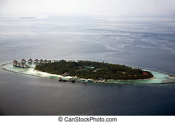 The Maldives - Aerial shot of a holiday resort island in the...