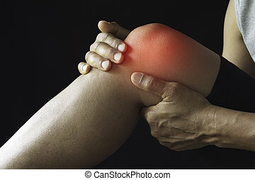 The male clings to a bad knee. The pain in his knee. Health and painful concept.