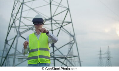 The male engineer manages the transmission of alternative...