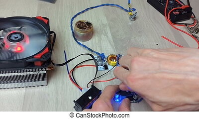 Repair of electronic devices, tin soldering parts - The man...
