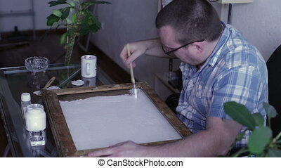 The man apply primer on canvas