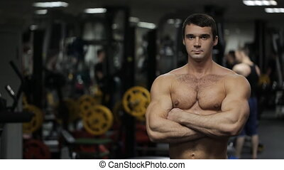 The man, athlete, personal trainer with steely glance and...