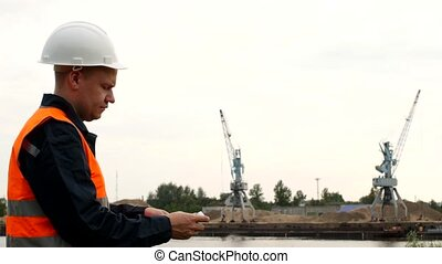 The man boss recounts the euro money proceeds from the extraction of river sand in the port