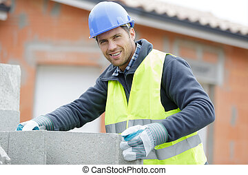 the man-builder works with concrete