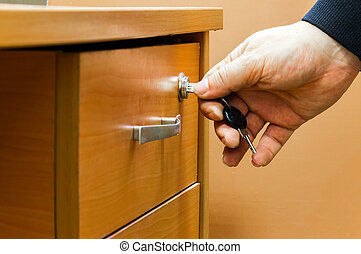 man closes the drawer - The man closes the drawer of the...