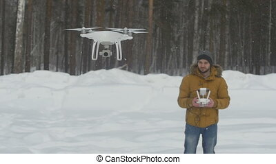 The man controls the drone - The man with the help of radio...