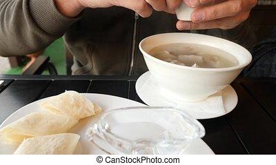 The man crumbles dry lavash into Hash soup - Armenian...