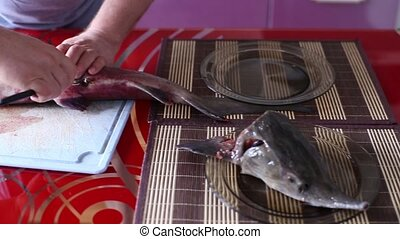Man Cuts Belly Of A Fish - The Man Cuts Belly Of A Fish