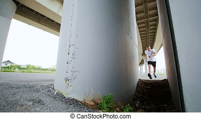The man does the trick under the bridge, slow motion,...