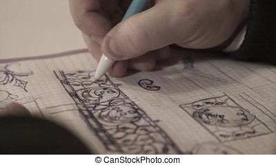 The man draws in a notebook,taking notes, the person writes...
