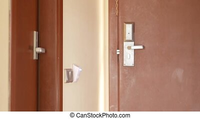 The man enters the hotel room and turns on the electricity...