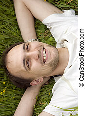The man having a rest on a grass
