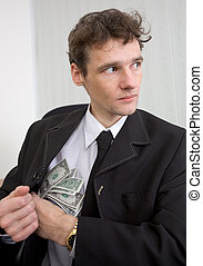 The man hides money - The man in a suit hides money for a ...