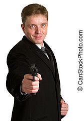 The man in a suit aims from a pistol