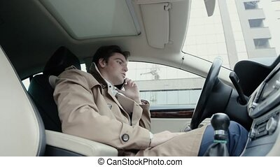 The man in the car talking on the phone