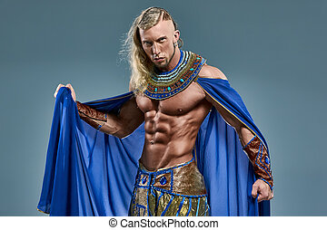 The man in the image of the ancient Egyptian Pharaoh on blue background