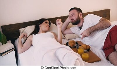 the man in the morning in the bedroom woke his wife breakfast in bed