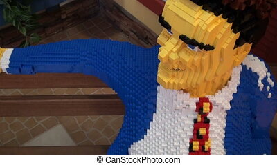 The man in the natural size of the LEGO