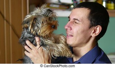 The man is friendly with the dog. Love of pets indoor