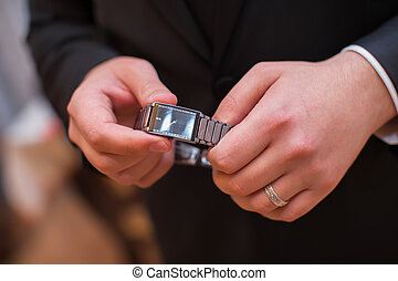 The man is holding hands for hours and has a ring in his hand