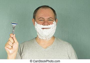 the man is shaving