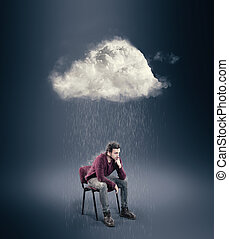 The man is sitting on a chair and thinking with a cloud over his head.