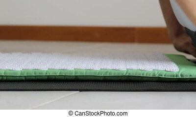 The man lies on acupuncture mat for massage. Close-up. - The...