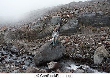 The man looking to the majestic mountain stones
