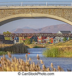 The man made Oquirrh Lake with view of two bridges