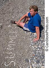 The man on a stone beach
