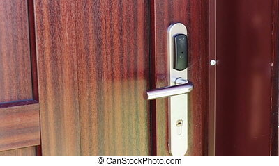 The man opens the door to an electronic key - card.