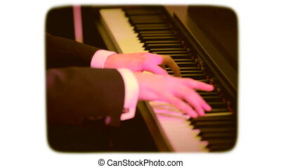 The man playing the piano. retro style film 1970s. - Men's...