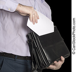 The man puts a sheet of white paper in his briefcase. Place for text. Isolate on black.