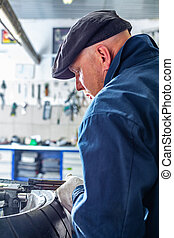 man repairing motorcycle tire with repair kit, Tire plug ...