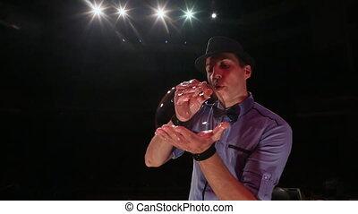 The man the actor stirs up a soap bubble. Soap bubbles show.