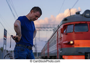 The man was late for the train stands with his head down