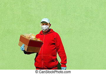 man with a box of food, help and donation of food