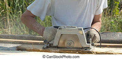 The man with a circular saw