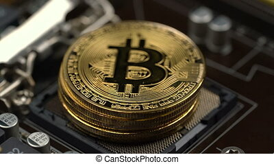 the man's hand picks up bitcoins one by one which lie on the processor socket