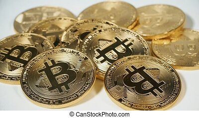 The man's hand taking the bitcoins. Crypto currency Gold...