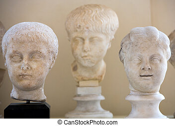 the marble-head scuplture in the baths of Diocletian (...