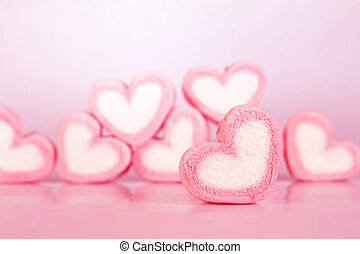 the marshmallow heart shape on pink background with love concept