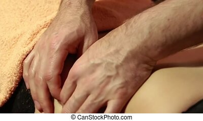 The masseurs fingers gently pinch the skin of the womans ...