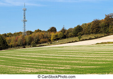 The mast - Mobile phone mast stands out against a clear blue...