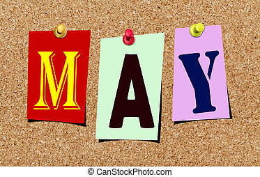 The may magazine cutout letters pinned to cork noticeboard