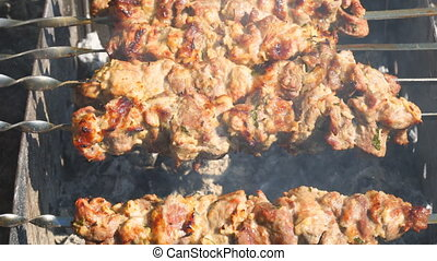 The meat is fried on charcoal. BBQ, shish kebab